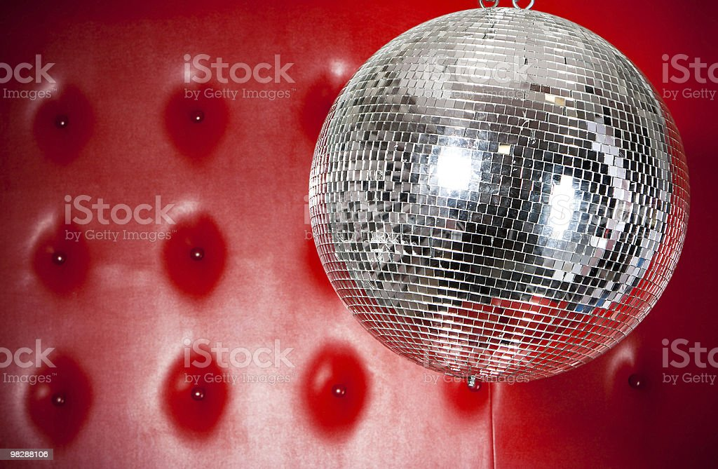 Discoball on red background royalty-free stock photo