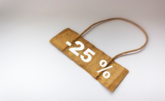 Discount 25 on sale on promotion. On tag and white isolated background 25 percent sale text, advertisement.