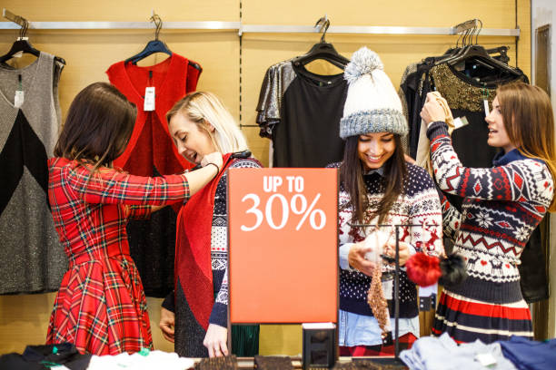Discount in the clothing store Happy and satisfied girls because of the discount in the clothing store discount store stock pictures, royalty-free photos & images