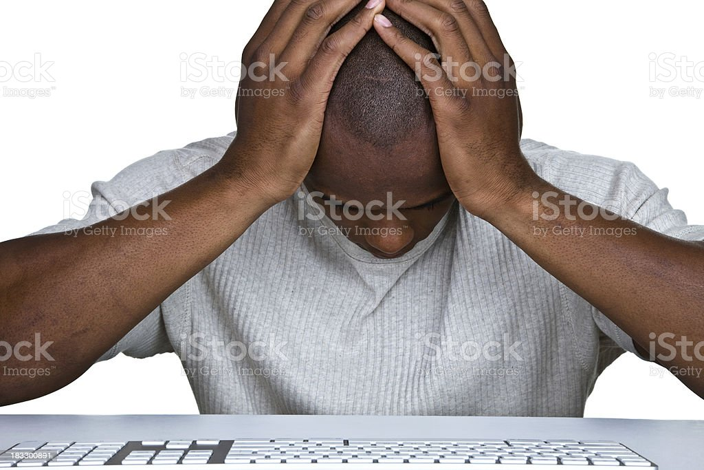 Discouraged man sitting in front of a computer stock photo