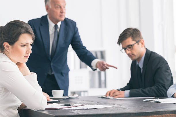 Discouraging atmosphere in the workplace stock photo