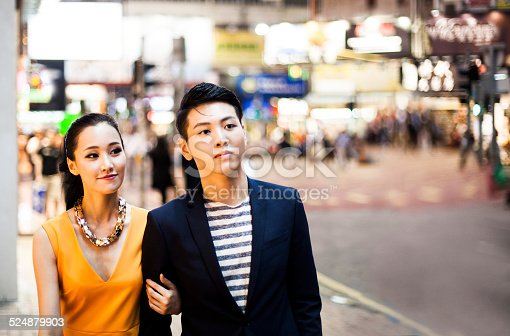 Young couple walking in Hong Kong. Shopping in Causeway Bay district.