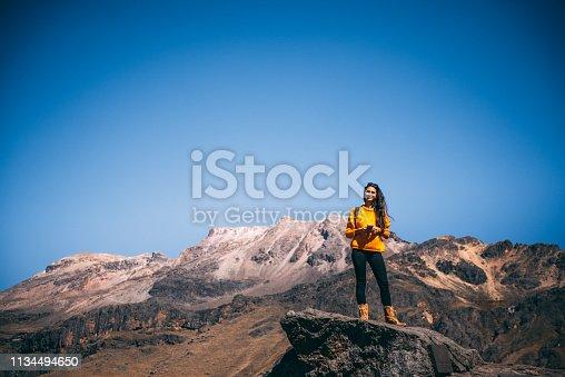 Young Latin woman enjoying the view to Iztaccihuatl volcano