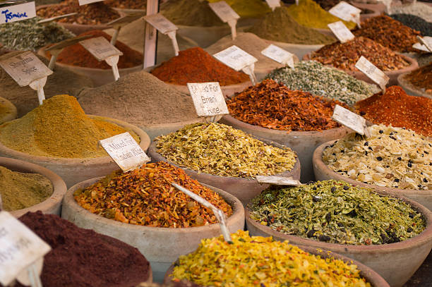 discovering new spices and dehydrated food spices for cooking on sale at the city bazaar asian market stock pictures, royalty-free photos & images