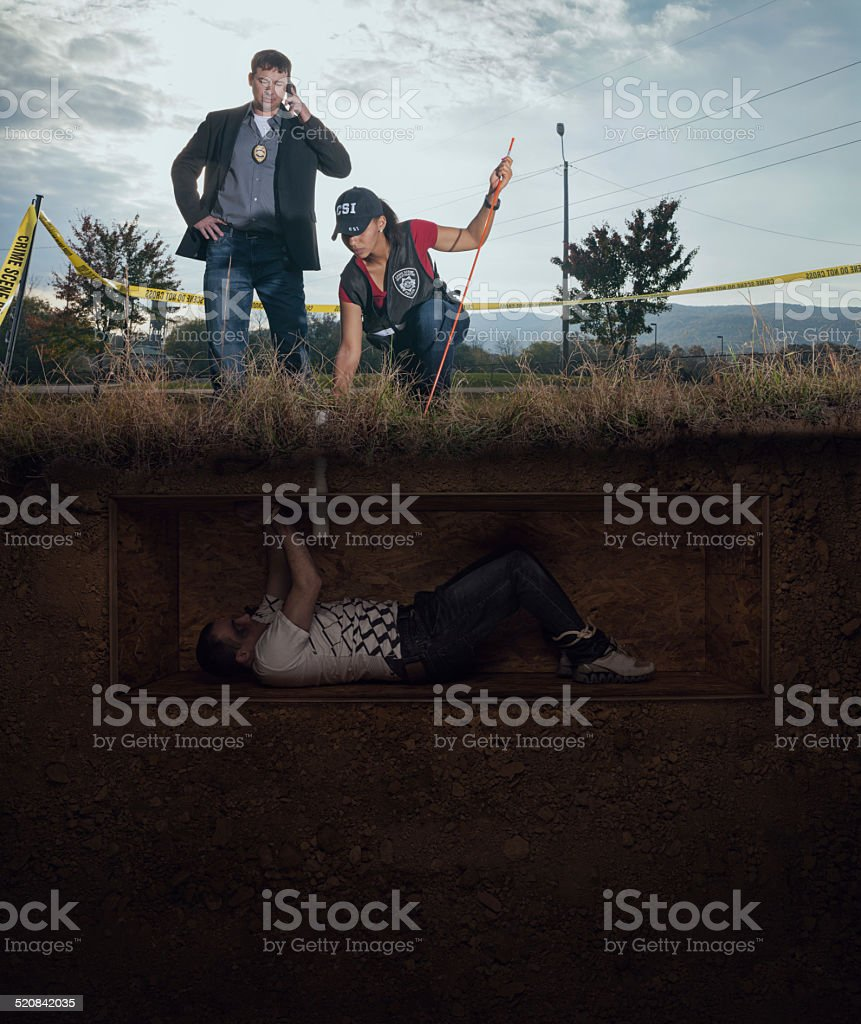 CSI discovery of a male victim buried alive stock photo