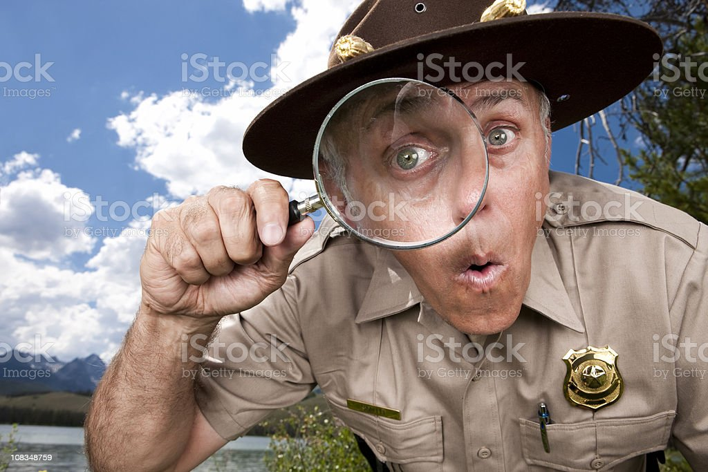 Discovery: Park Ranger with Magnifying Glass stock photo