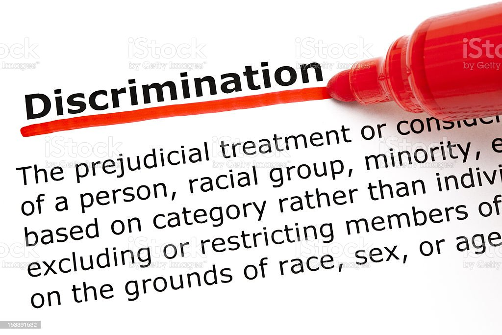 Discrimination underlined with red marker stock photo