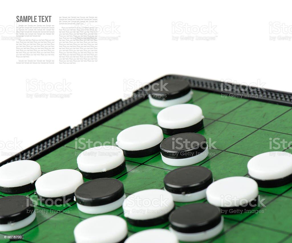 discs on Reversi Board stock photo