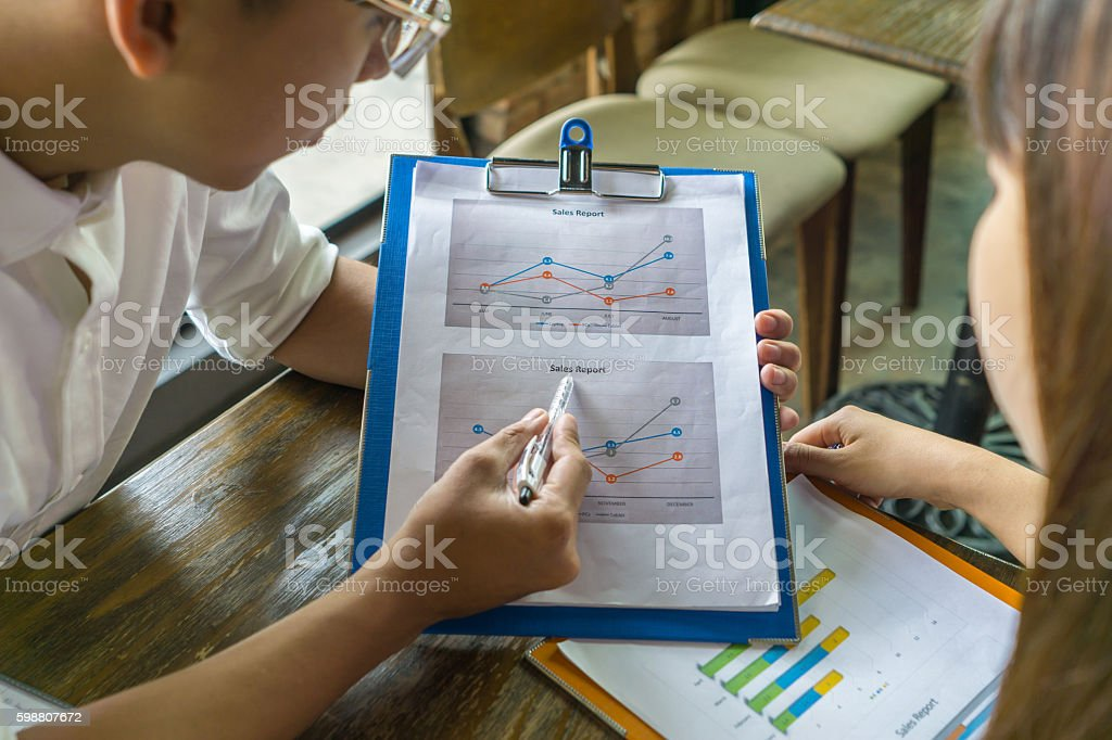 Discuss about the graph on sales report stock photo