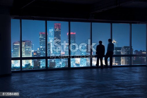 businessman discuss something,the view outside the window is CBD of beijing.the economic centre of beijing,china.