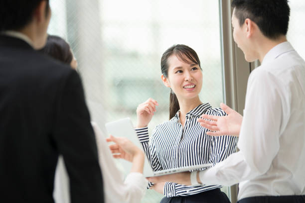 Discuss with a smile. Conference using computer. japanese ethnicity stock pictures, royalty-free photos & images