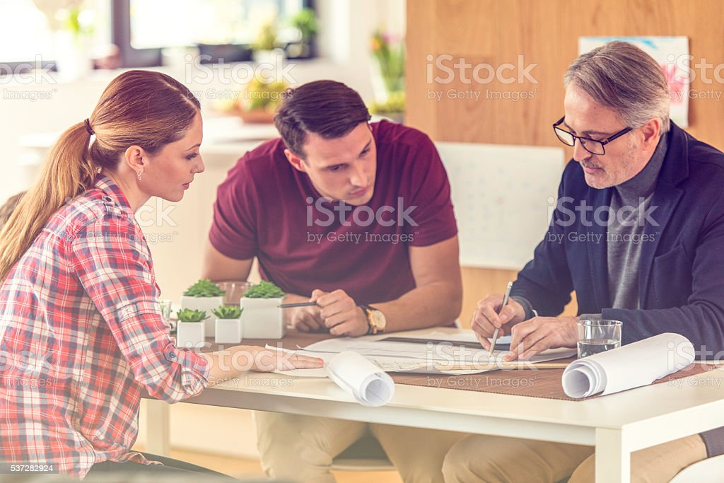 Discussing a blueprint stock photo