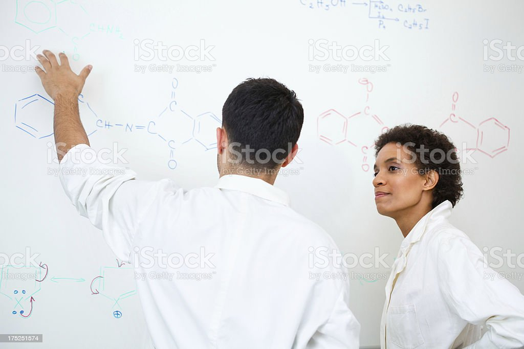 Discussing about chemical formula royalty-free stock photo