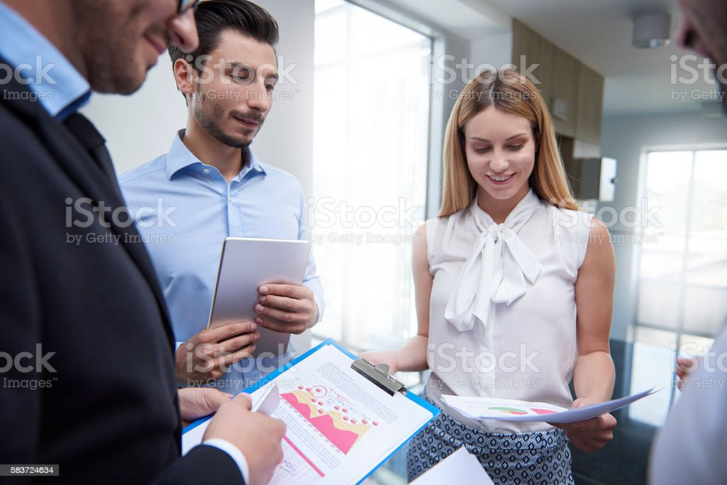 Discussing and analyzing important documents stock photo