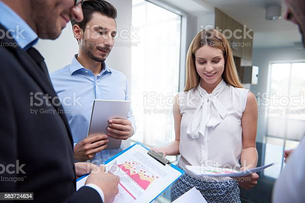 Discussing And Analyzing Important Documents Stock Photo - Download Image Now
