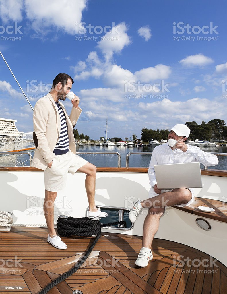 Discussing business and drinking coffee on the luxurious yacht royalty-free stock photo
