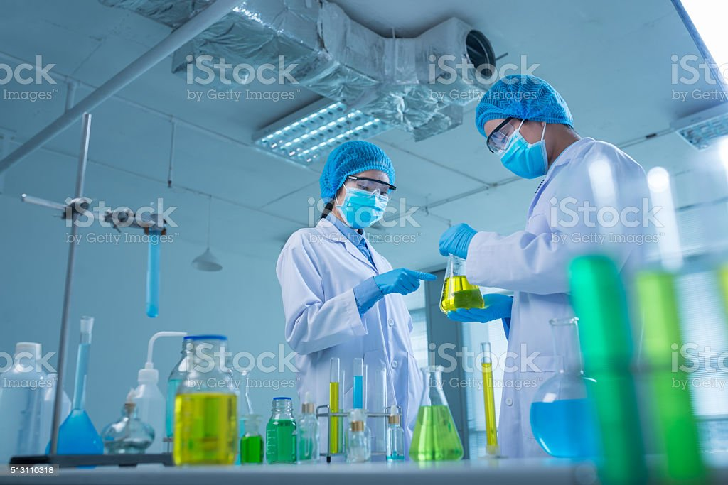 Discussing chemical liquids stock photo