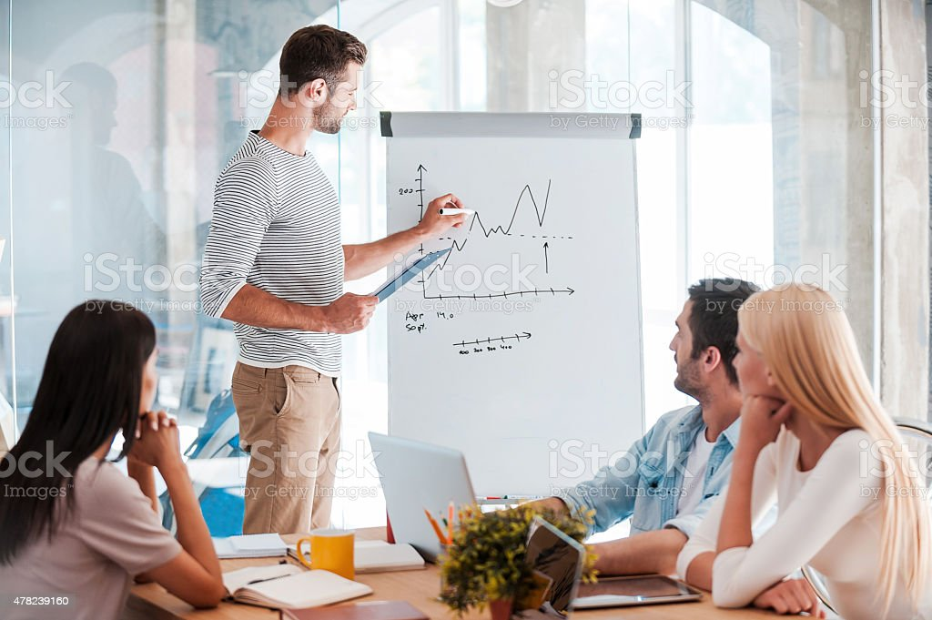 Discussing company progress. stock photo