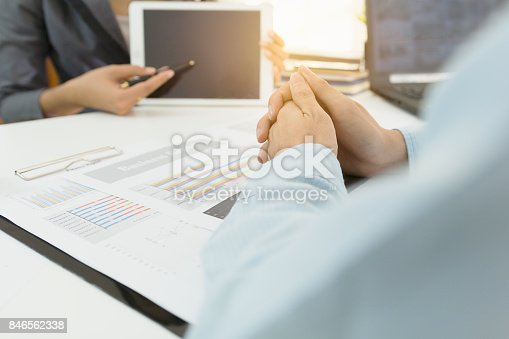 858031152istockphoto Discussing Concept. Close up people hold hands with Business partners presentation or discussing the new project. 846562338