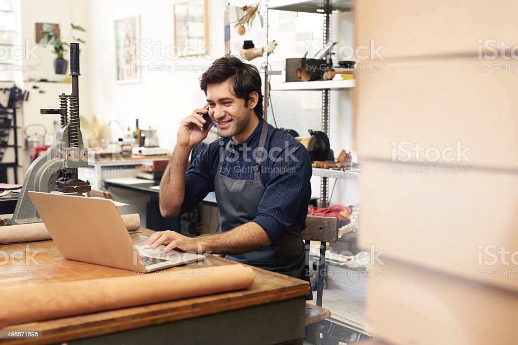 Discussing design specs with a client stock photo