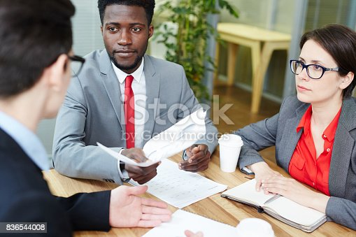 istock Discussing financial documents 836544008