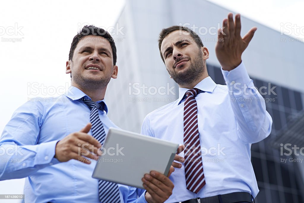 Discussing future construction royalty-free stock photo