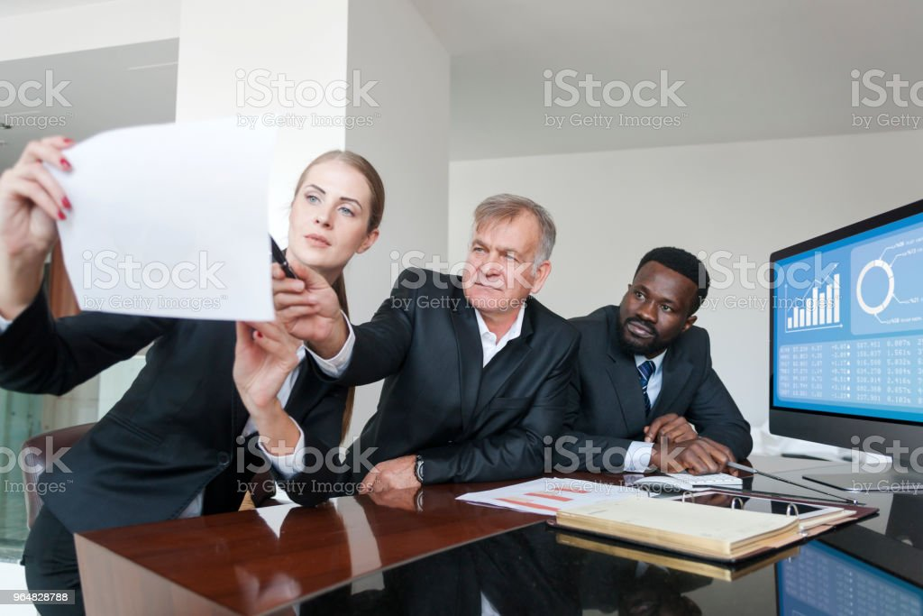 Discussing ideas for their company's online profile royalty-free stock photo