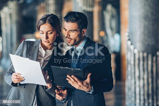 istock Discussing important documentation 890001030