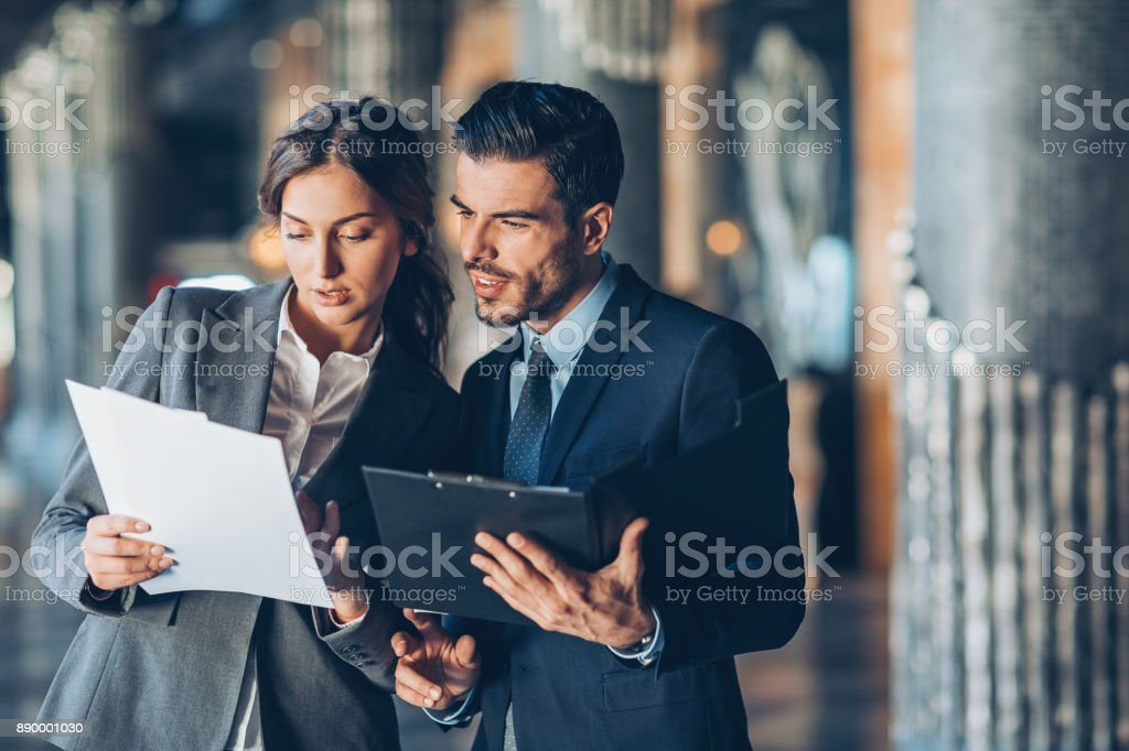 Discussing important documentation stock photo