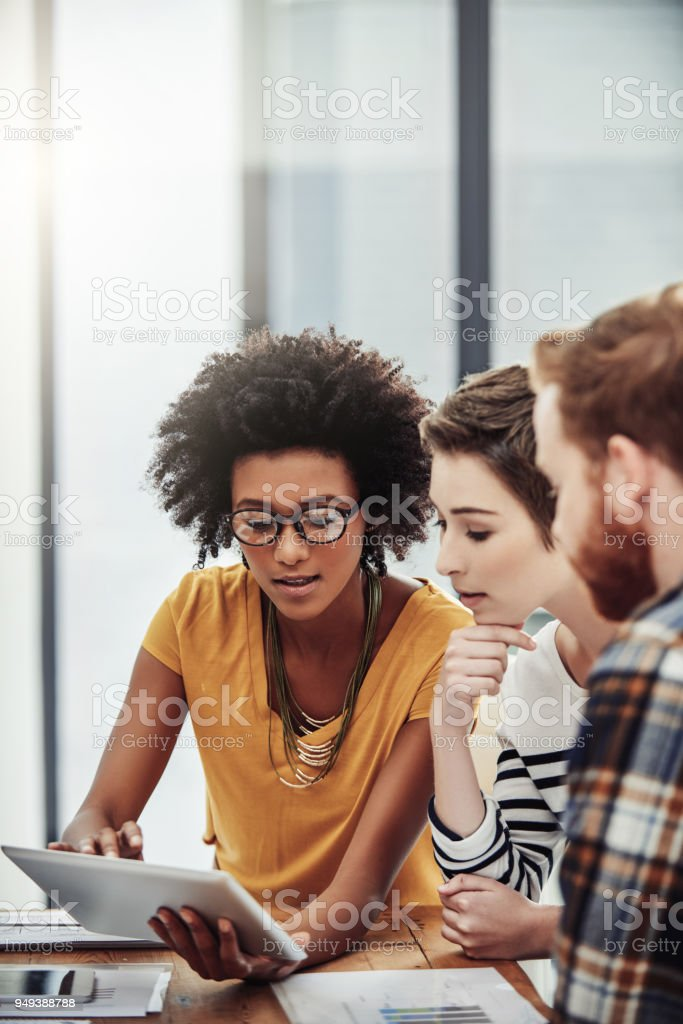 Discussing key points of interest stock photo