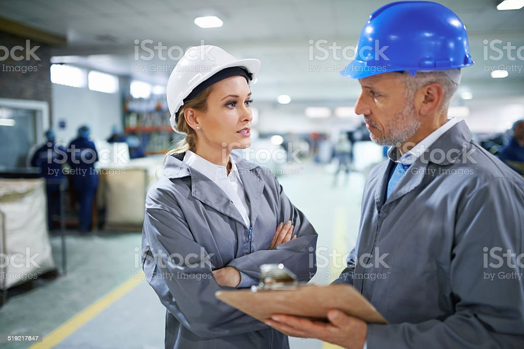 Discussing logistics stock photo