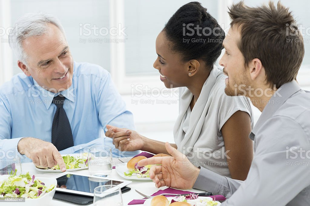 Discussing of Work at Lunch stock photo