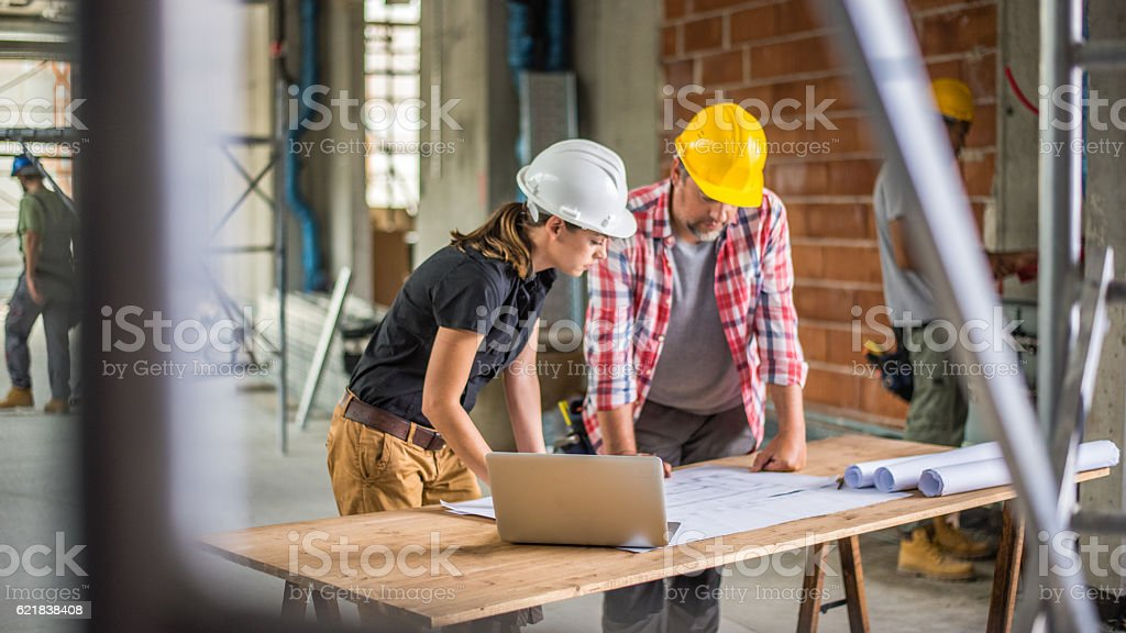 Discussing on blueprint stock photo