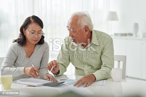 istock Discussing papers 519266338