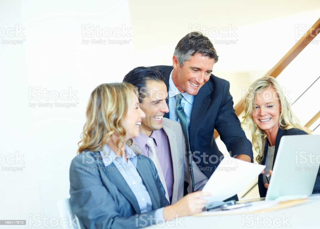 Discussing project on laptop royalty-free stock photo