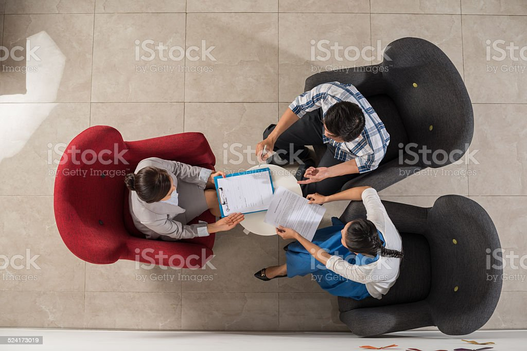Discussing real estate sale contract stock photo
