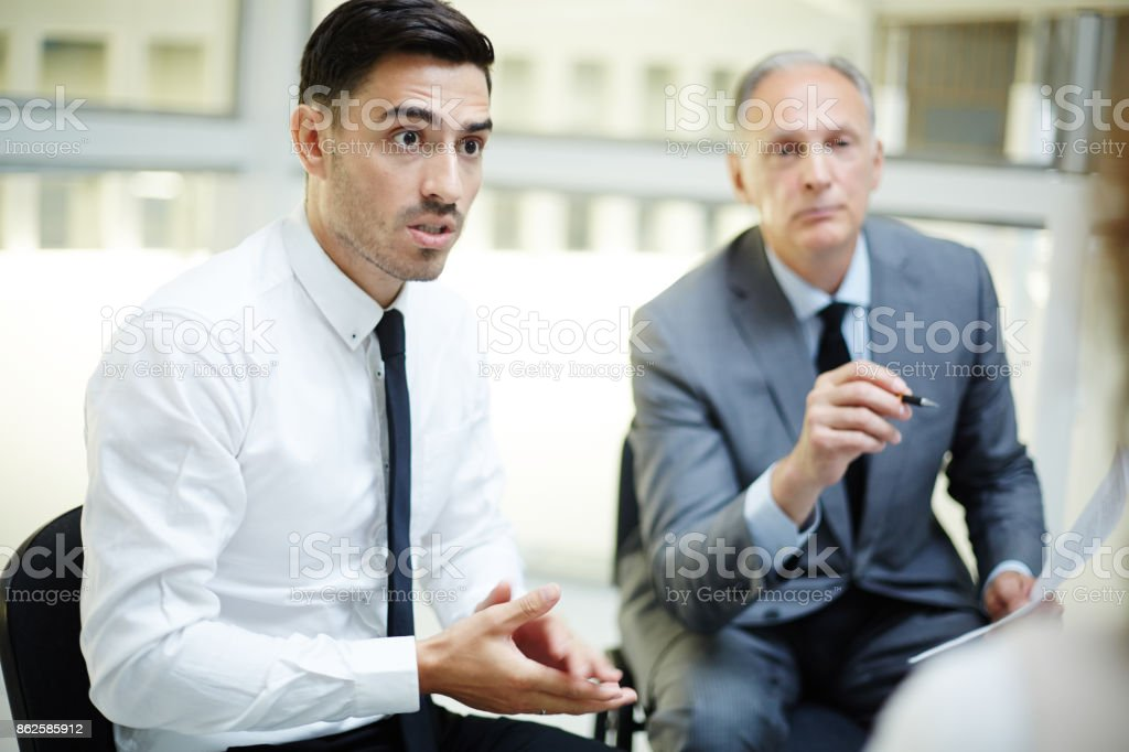 Discussing report stock photo