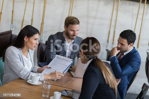 istock Discussing reports in the office 1011254290