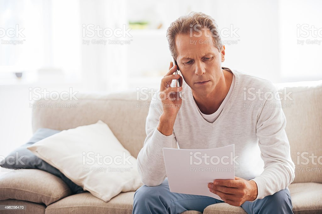Discussing that document. stock photo
