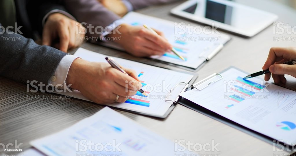 Discussing the scheme. stock photo