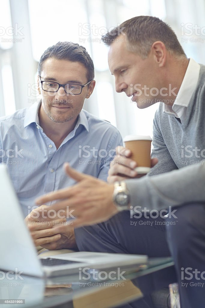 Discussing their business plan royalty-free stock photo
