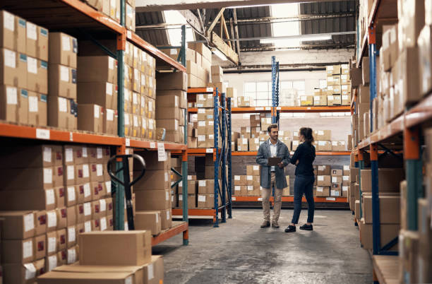 Discussing ways to utilise the factory floor its full capacity stock photo