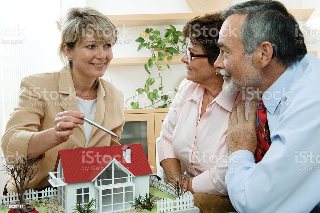 discussing with realtor royalty-free stock photo