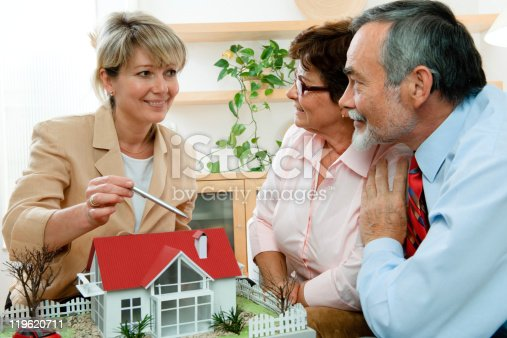 594910248istockphoto discussing with realtor 119620711