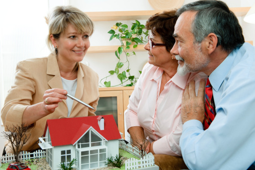 594910248 istock photo discussing with realtor 119620711