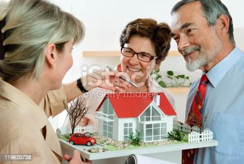 594910248istockphoto discussing with realtor 119620738