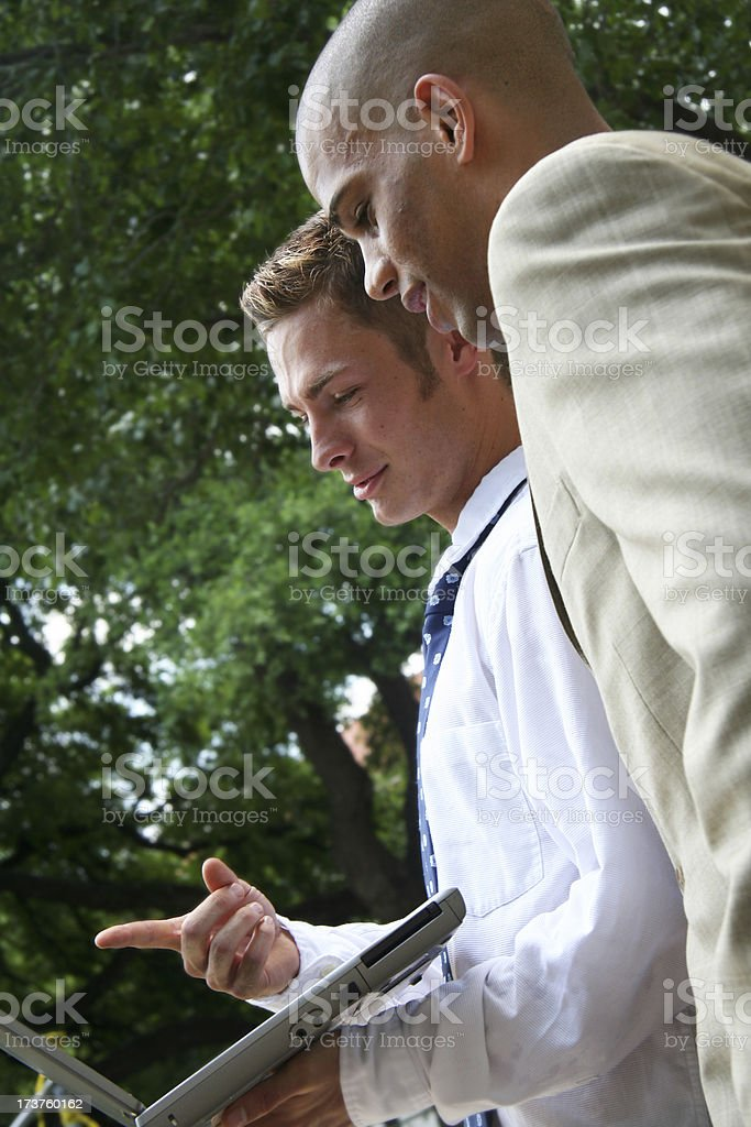 Discussing Work On Their Laptop stock photo