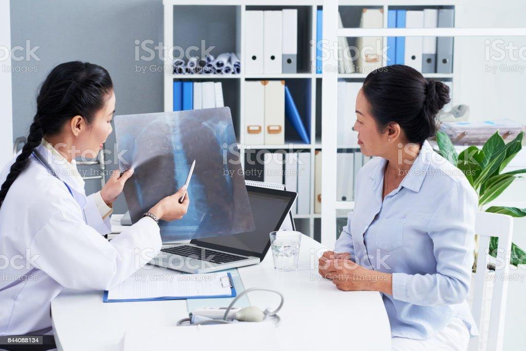 Discussing x-ray stock photo