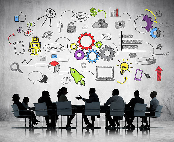 discussion at a table with graphic overhead. - business icons stock photos and pictures