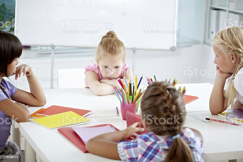 Discussion at school desk royalty-free stock photo